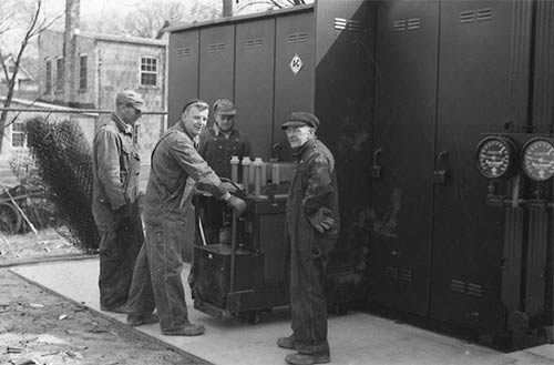 Vintage photo of men working at power supply